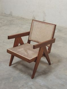 A high quality reproduction of the Easy Armchair, a mid-century modern lounge chair designed by Pierre Jeanneret for various buildings in the