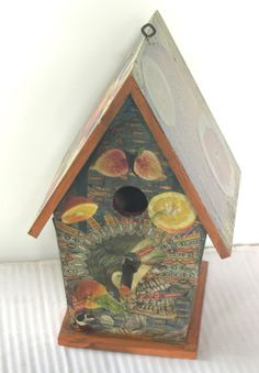 """Folk Art Screamer ""  Decoupage bird house created and designed by Linda Pastorino 2010"