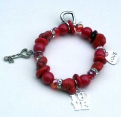 #bmecountdown Red Charm Bracelet - Love  4 different types of red beads make up this bracelet and give it a chunky look. There are red glass beads, Czech crystals, coral and red glass turquoise beads. Also, there are crystal rondelles to bling it up. 4 charms: a heart,a key. and 2 love charms in pewter. Red is the color of love. These are matching earrings https://www.etsy.com/listing/174015839/red-round-gemstone-earrings-red-gemstone?ref=listings_manager_grid It is a stretchy bracelet,