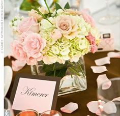The simple centerpieces were square glass vessels filled with white hydrangeas, spray roses, white stock flowers, Sahara roses, and pink roses. Mocha-colored table linens tied in the color palette. White Hydrangea Centerpieces, Simple Centerpieces, Wedding Centerpieces, Wedding Table, Wedding Bouquets, Wedding Flowers, Wedding Decorations, White Hydrangeas, Glass Centerpieces