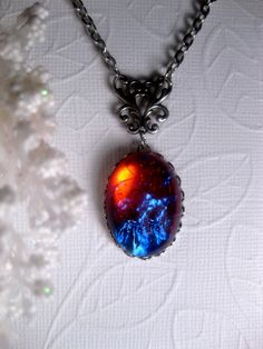 Dragon's Breath Mexican Opal Pendant Necklace. $28.00, via Etsy.