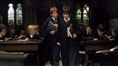 The first book was released in the United States in 1998 with the title 'Harry Potter and the Sorcerer's Stone'. Pictured is a clip from the 2001 film with Rupert Grint (left) as Ron Weasley and Daniel Radcliffe (right) as Harry Potter Harry Potter Fan Theories, Saga Harry Potter, Potter Facts, Harry Potter Movies, James Potter, Harry Potter Sempre, Mundo Harry Potter, Cho Chang, Lord Voldemort