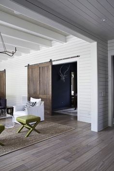Even when they aren't necessary for functional use, barn doors add so much style to a room. These wood doors add depth and warmth to this living room.