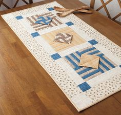 """Recently, while working on several new table runner patterns, I had tossed a few small blocks on top of a pile of larger blocks, when I noticed that one of the small blocks looked like it was sort of floating above a larger block. Immediately an idea was hatched, and the """"Floating Diamonds"""" table runner was born."""
