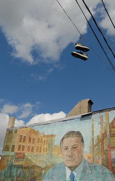 Nothing Says Philly Like a pair of sneakers hanging from the overhead wires in front of a building-sized mural of former Mayor Frank Rizzo, looking like the king of South Philly.