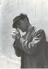 """Male prostitute lighting his cigarette, in Trafalgar Square (late 1920s)  Trafalgar Square was, in the 1930s, a well-known """"cruising"""" area, and was affectionately known as """"The meat rack""""!"""
