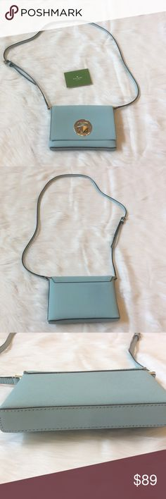 """Kate Spade Crossbody This is a Kate Spade Newbury Lane Sally Crossbody bag in EUC. Color is called blue hydrangea, it's a very pretty light blue almost like Tiffany blue. Features include saffiano leather, flap with turn lock closure, 14 karat gold plated hardware and adjustable 22"""" strap. Interior has one slip pocket. Measurements are 4.9""""H-7.4""""W-1.1""""D.This did not come with a dust bag. Has light scratches on hardware as seen in pics above. ⚜Please see my """"reasonable offers"""" listing at the…"""