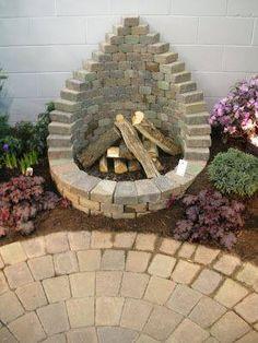 Pretty paver firepit.