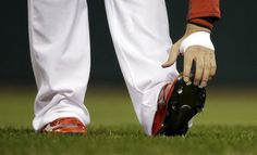 St. Louis Cardinals' Allen Craig adjusts his cleats before Game 5 of baseball's World Series against the Boston Red Sox Monday, Oct. 28, 2013, in St. Louis. (AP Photo/Jeff Roberson)