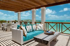 How can you not just love this terrace with its view of all of that spectacular turquoise water? This is in Turks and Caicos, where it is sunny most of the year, so it isn't much of a problem that the roof isn't one that would keep rain out. Having a comfortable place in which to lounge or eat is pretty much all you need.