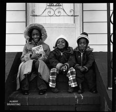 Many people from the rural areas in the South of the USA moved to New York. Tabia, Tyne and Tyrees on the porch in Queens NY ready for school.  - Photo-essay made in South-Carolina USA in 1981 around Hartsville and Bishopville, about the mainly black residents of these rural areas.