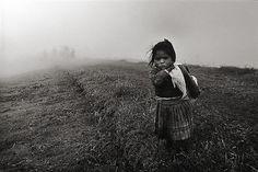 Girl in Field, The Community of Yuracruz, Ecuador by Sebastião Salgado