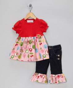 This pair is perfect for a petite sweet in need of a colorful ensemble. A winning combination of fun and functionality, the airy skirted top and sturdy denim bottoms hold up with every skip and tumble. Vibrant ruffles at the hem give this set a frilly finishing touch. Includes top and pants100% cottonMachine wash; tumble...
