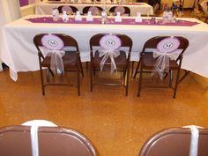 Turn them boring folding chairs into a wedding reception art piece. Add medallions to liven them up (sister's reception 10/11/14)