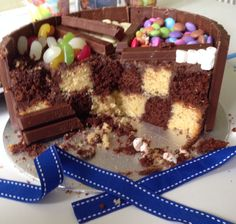 Here is a chequered sweetie cake I made with inspiration from Pinterest. With choc butter cream between all layers and outer edges, it was moist, delish and looked effective I thought!
