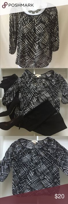 Michael Kors Blouse Black and White Michael Kors Blouse. Quarter Sleeves and cinched Sleeves and hemline. Material is 95% Polyester and 5% Spandex. Great shirt for Work with Dress Pants or a cute Pencil Skirt! Michael Kors Tops Blouses