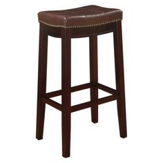 The Claridge Patches Brown Bar Stool will add stylish seating to any bar or high top table. The sturdy wood frame has a dark brown finish accented by a brown vinyl upholstered seat. Nailhead trim and accent stitching adds a patchwork design to the top for Brown Bar Stools, 30 Bar Stools, Counter Stools, High Top Table Kitchen, High Top Tables, Patio Bar Set, Pub Table Sets, Backless Bar Stools, Pub Set