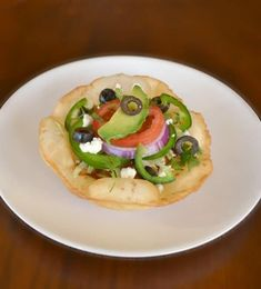 My entire family LOVES Mexican food. We eat it at least once a week – tacos, fajitas, enchiladas, and on special occasions (or to impress company) chicken tostadas. The chicken tostadas are our absolute favorites. I'll share some shortcuts with you so you can adapt it into an easier meal. The nice thing about these tostadas is that everyone makes their own, by choosing what toppings they want to add on, so each person's tostada is perfect for him or her.