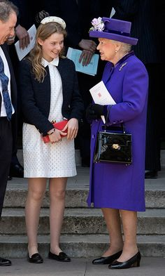 Queen Elizabeth showed she's a fan of regal purple as she chatted with great-niece Lady Margarita Armstrong-Jones, who served as flowergirl for Prince William and Duchess Kate's wedding, at Westminster Abbey. The 14-year-old royal looked very ladylike herself in an eyelet lace dress and flats.