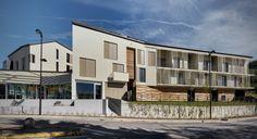 Residential and Commercial Complex in Azzate by @parkassociati #Azzate #Varese #Italy #2010 #Residential #Complex #Landscape #Architecture #Design #Facade #Facciata #Concrete #Wood #Glass #Contemporary #Modern #Spanroof #Woodlamella #Veranda #Zinc-Titanium #ParkingArea #Fountain #FIMGroup #Garden #Giardino #ResidentialLiving #Residenza #Contemporaneo