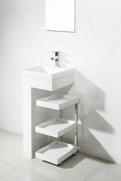 Very modern sink and storage. Would be perfect for a small treatment room!