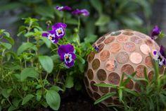 20 Outdoor Crafts To Do This Summer | HGTV Crafts To Do, Crafts For Kids, Penny Ball, How To Make Ceramic, Tin Can Lanterns, Gardening For Dummies, Metal Garden Art, Garden Show, Box Garden