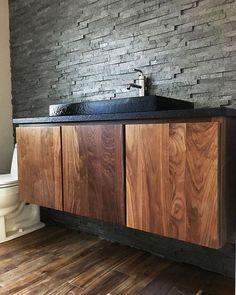 We\'re in love  with this gorgeous custom #walnut #floatingvanity designed by @meganras620 and built by the talented craftsmen at Arrow Millwork & Cabinetry! / #regram #arrowmillwork #customcabintery #interiordesign #bathroomdesign #bathdesign #instadesign #wallmountvanity #bathroomvanity