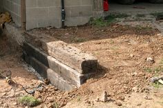 So, we've got this spot by the entrance to the new wood shop that needs a retaining wall. We had to dig the floor to the new wood shop down about 10 inches. On top of the fact that it was alr…