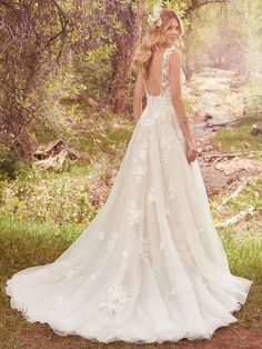 Shop the Maggie Sottero Meryl Wedding Dress! In dotted tulle and organza, this sleeveless ball gown features lace appliques, a V-neckline, and a low back. Vintage Inspired Wedding Dresses, Garden Wedding Dresses, Elegant Wedding Gowns, Best Wedding Dresses, Whimsical Wedding, Whimsical Dress, Weeding Dresses, Ethereal Wedding, Floral Wedding