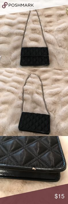 """Black faux leather wallet purse Black faux leather wallet purse in fairly good condition. Some white marks on it that have been pictured. Measures approximately        7 1/2X4 1/2"""". Chain measures 17"""" Bags Mini Bags"""