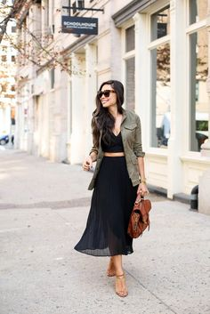 A field jacket over a crop top and a flowy skirt.