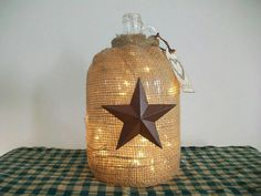 Glass jug covered in burlap.  May need to do this to my old jug!