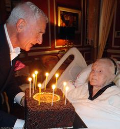 Zsa Zsa Gabor is presented with a birthday cake by husband Frederic Prinz von Anhalt on her 95th birthday