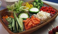 This is a Longaberger basket with a liner. I really liked the use of green peppers to hold the vegetable dip. We cut the cucumbers in spears instead of slices to make them easier to dip.