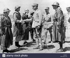 General Giraud of the French Army inspects and congratulates his Goumier troops who distinguished themselves during the Sicilian campaign while fighting under American command. Pin by Paolo Marzioli East Africa, North Africa, Italian Campaign, French Foreign Legion, Ww2 Pictures, Free In French, French Colonial, French Army, Military Diorama