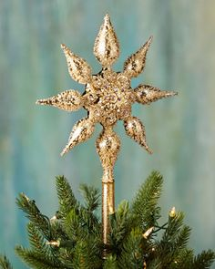 "Handcrafted tree topper. Made of mouth-blown glass. Hand painted. Accented with Swarovski crystals. Approximately 9.5""W x 2""D x 13.75""T. Made in Germany."