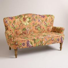 Ideal for small spaces, our comfortable vintage-inspired loveseat features a contoured camelback silhouette and vibrant floral-patterned upholstery.