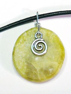 Connemara marble circular creamy yellow by WildAtlanticCraft Celtic Spiral, Marble Necklace, Connemara, Leather Necklace, Green Leather, Shades Of Green, Yellow, Pendant, Handmade