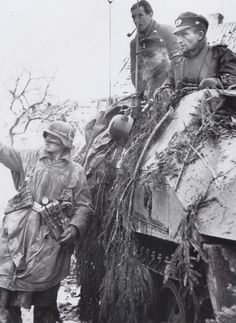 Soldiers from 116th Panzer Division were halted on a road to check position during Battle of the Bulge.