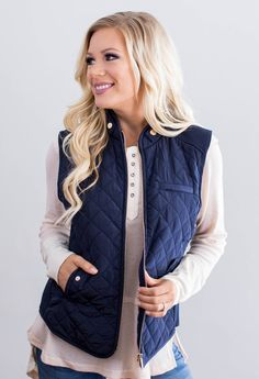 """Quilted, padded vest with a vip up front. 100% Polyester Model is 5'7"""" size 6 in a small. Shown with our Elizabeth Lace Accent Top.    Measurements Length Bust   Small 24.5"""" 38""""   Medium 25"""" 40""""   Large 25.5"""" 42"""""""