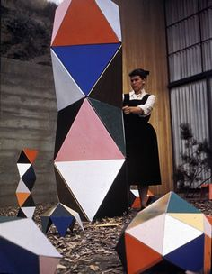 Ray Eames outside the Eames House with a model for the The Toy, designed by Charles and Ray Eames.