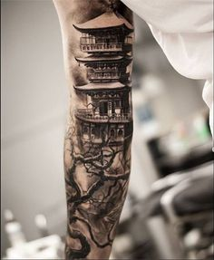 A neat temple by black and grey master Oscar Akermo.