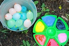 Get a tray with marbles or smaller round object and distribute paints, round objects,(can have different textures) and let them have fun. Can do them outside so the balls with paint