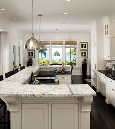 "LOVE THE DESIGN OF THIS ISLAND! Bi-level u-shaped island should house the kitchen sink and dishwasher (instead of  cooktop and prep sink), and it accommodates stools on three sides without additional ""table"" extending out the front."
