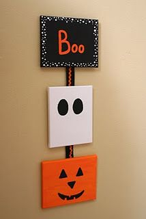 Halloween Canvas Wall Art- Boo! This is a little simple, but I like it and there's actual instructions on what you need to put it together!