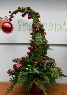 First Class Flowers are known for their unique Grinch Trees. They are available for Calgary and area delivery only. Actual colours may vary. Order Grinch Tree from FIRST CLASS FLOWERS LTD. Grinch Trees, Grinch Christmas Tree, Grinch Christmas Decorations, Christmas Arrangements, Christmas Flowers, Christmas Home, Christmas Holidays, Christmas Wreaths, Christmas Crafts