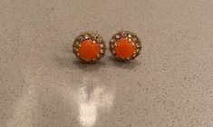 Worn a handful of times! Orange coral faux stone surrounded by rhinestones. Gold plated stud earrings. Some minor wear to plating. Kate Spade Earrings, Stud Earrings, Faux Stone, Rhinestones, Plating, Coral, Times, Orange, Gold