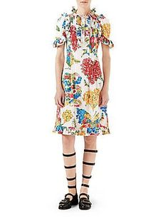 Gucci Corsage Print Cotton Dress The first thing that popped into my head was pippy longstocking.