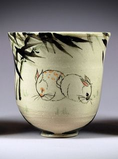Two rabbits on a stoneware cup under brushpainted bamboo by Tracie Griffith Tso click now to see more. Modern Ceramics, Contemporary Ceramics, Ceramic Cups, Ceramic Pottery, Stoneware, Bamboo, Interior Design, Deco, Handmade