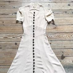 { Sold } Purchased this linen 1930s dress (with 22 buttons!) for myself, but has a similar button down dress so will be selling. This dress has puff sleeves, shirrings and beautiful topstitch details.